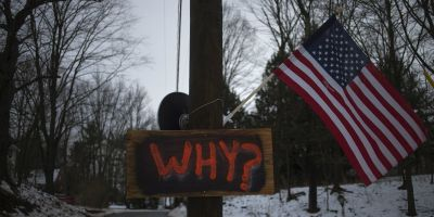 A sign posted on an electricity pole outside a house near Sandy Hook Elementary School. (Reuters/Adrees Latif)