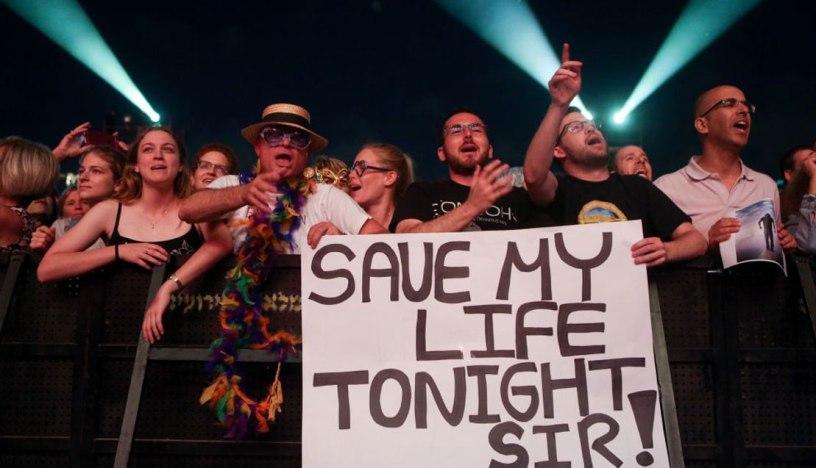 Fans watch Sir Elton John perform in Tel Aviv on May 26, 2016. (Miriam Alster/Flash90)